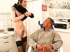 Dame with piercings sucks penis