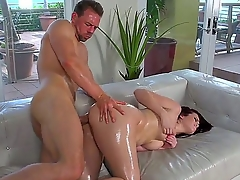 Hot brunette Ryan oils up her big booty and watches painless her wet tight pussy is fucked steadfast